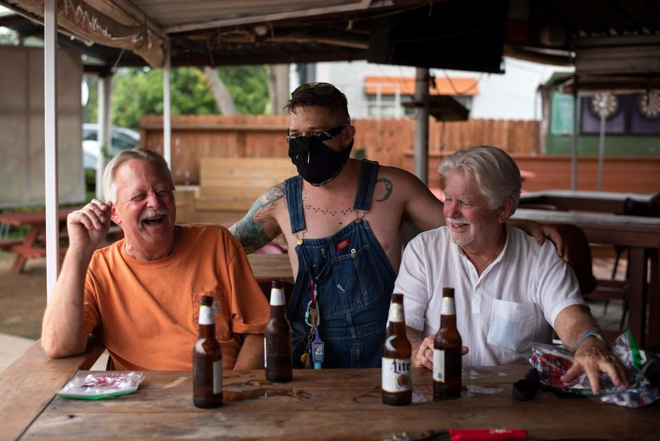 Visitors at West Alabama Ice House have a beer before Texas Governor Greg Abbots orders all bars to close today at noon in Houston, Texas, June 26, 2020. / Credit: MARK FELIX / AFP / AFP via Getty Images
