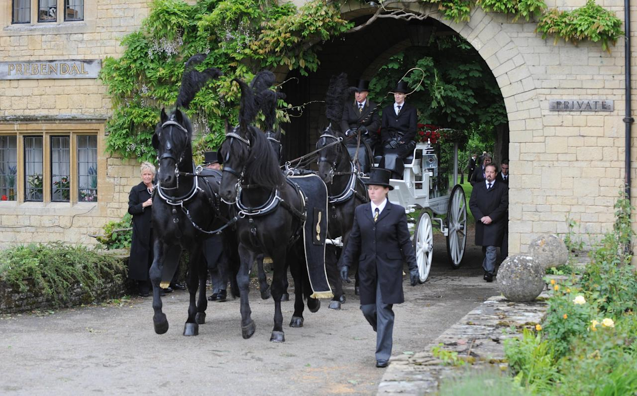 OXFORD, UNITED KINGDOM - JUNE 08: General view of Robin Gibb's horse drawn glass carriage during his funeral at Priest End, Thame on June 8, 2012 in Oxford, England.  (Photo by Stuart Wilson/Getty Images)
