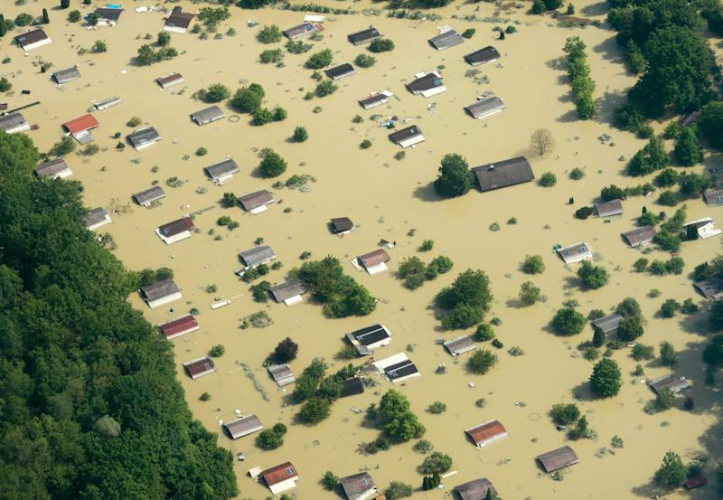 Aerial view of a flooded garden plot near the river Danube in Deggendorf, southern Germany, pictured Friday, June 7, 2013. Heavy rainfalls in the past days caused flooding along rivers and lakes in Germany, Austria, Switzerland, Hungary and the Czech Republic. (AP Photo/dpa, Armin Weigel)