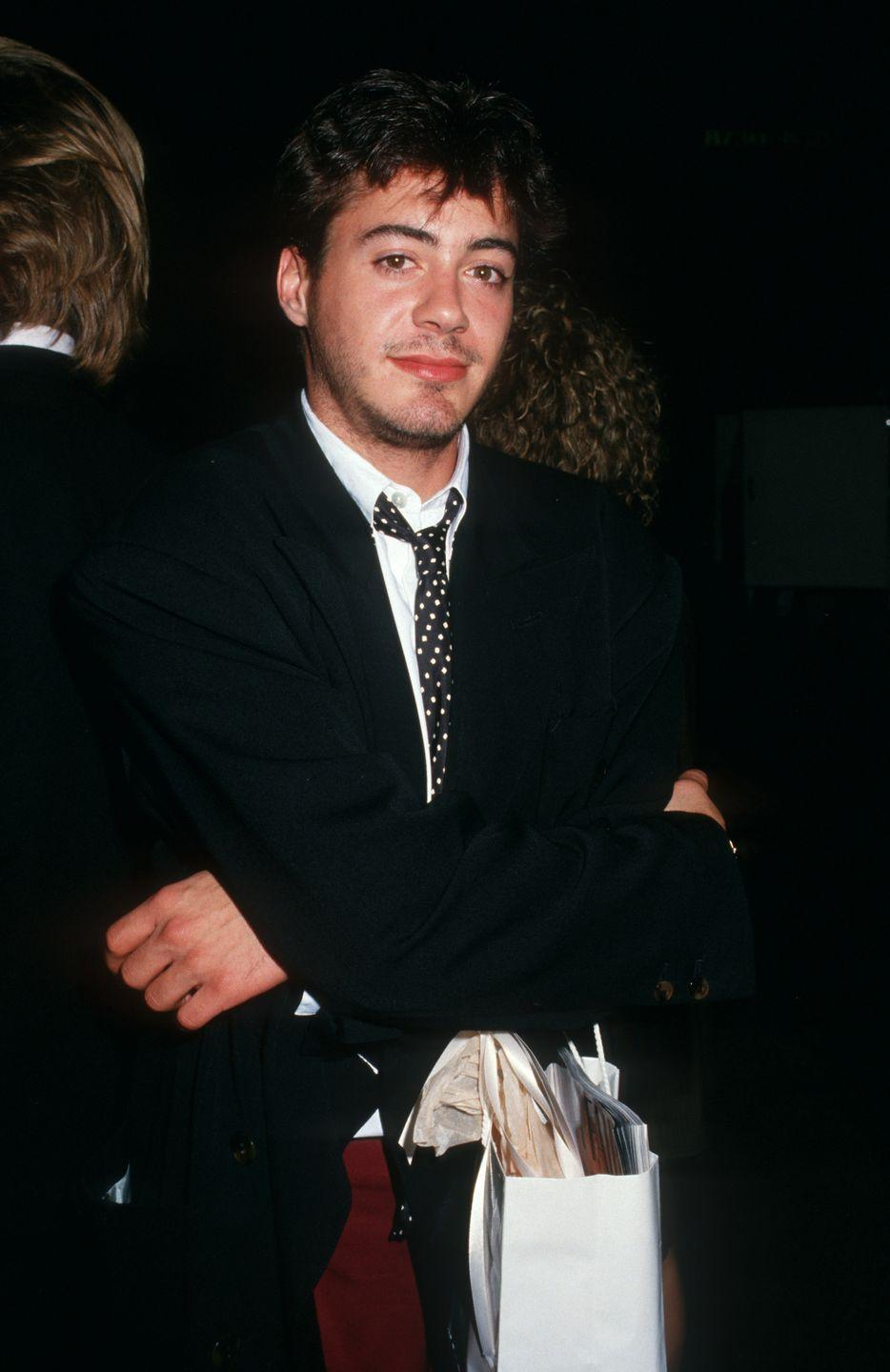 """<p>Heartthrob Robert Downey Jr. was once considered a part of the """"Brat Pack"""" after appearing in <em>Weird Science </em>(1985), <em>Back to School</em> (1986), <em>Less Than Zero</em> (1987), and <em>Johnny Be Hall </em>(1988). He was also a semi-regular cast member of <em>Saturday Night Live </em>in 1985, which helped jumpstart his career. </p>"""