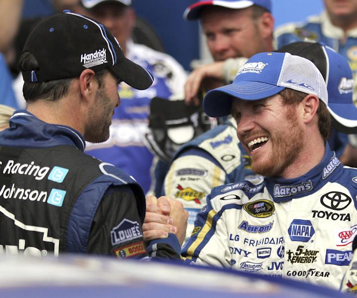 Brian Vickers, right, is congratulated by Jimmie Johnson in Victory Lane after winning the NASCAR Sprint Cup Series auto race, Sunday, July 14, 2013, at New Hampshire Motor Speedway in Loudon, N.H. (AP Photo/Mary Schwalm)