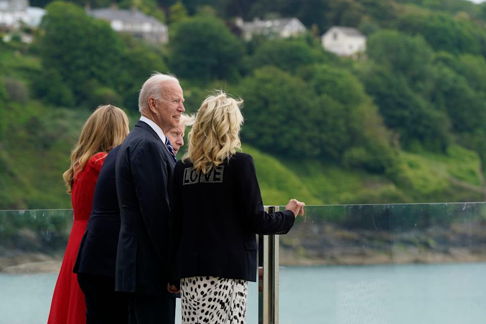 President Joe Biden and first lady Jill Biden are greeted by British Prime Minister Boris Johnson and his wife Carrie Johnson, ahead of the G-7 summit in Cornwall, June 10, 2021, in Carbis Bay, England.