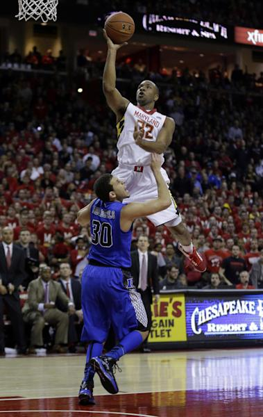 Maryland guard Dez Wells, top, shoots over Duke guard Seth Curry in the second half of an NCAA college basketball game in College Park, Md., Saturday, Feb. 16, 2013. Maryland won 83-81. (AP Photo/Patrick Semansky)