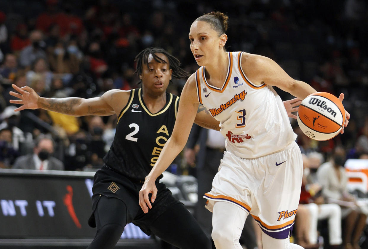 Mercury star Diana Taurasi drives against the Aces' Riquna Williams during Game 2 of the 2021 WNBA semifinals at Michelob ULTRA Arena in Las Vegas on Sept. 30, 2021. The Mercury defeated the Aces 117-91 behind Taurasi's playoff career-high 37 points. (Ethan Miller/Getty Images)