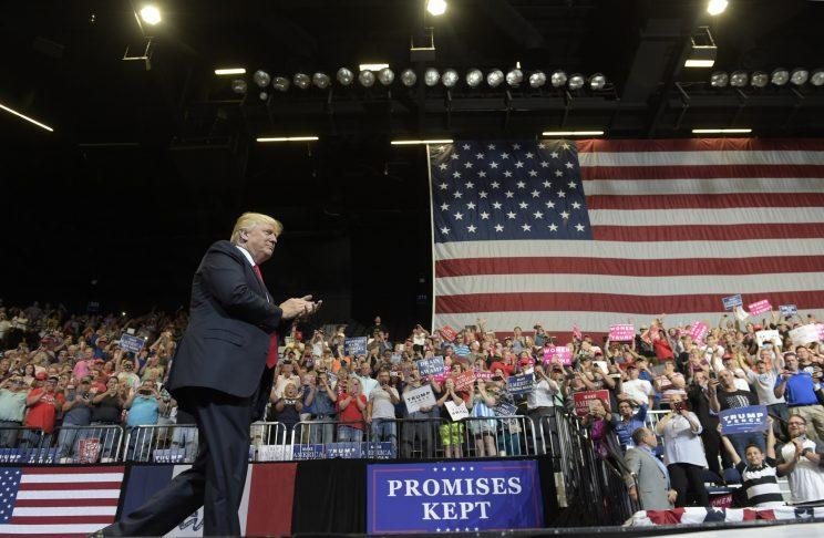 President Donald Trump arrives on stage to speak at the U.S. Cellular Center in Cedar Rapids, Iowa, Wednesday, June 21, 2017. (Photo: Susan Walsh/AP)