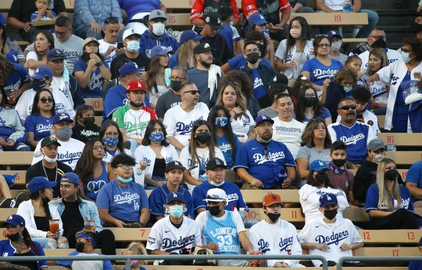 LOS ANGELES, CA - AUGUST 20, 2021: Most fans in the bleacher seats are wearing masks as tonight is the beginning of a new LA County health mandate requiring venues with more than 10,000 people to require masks at Dodger Stadium on August 20, 2021 in Los Angeles, California.(Gina Ferazzi / Los Angeles Times)