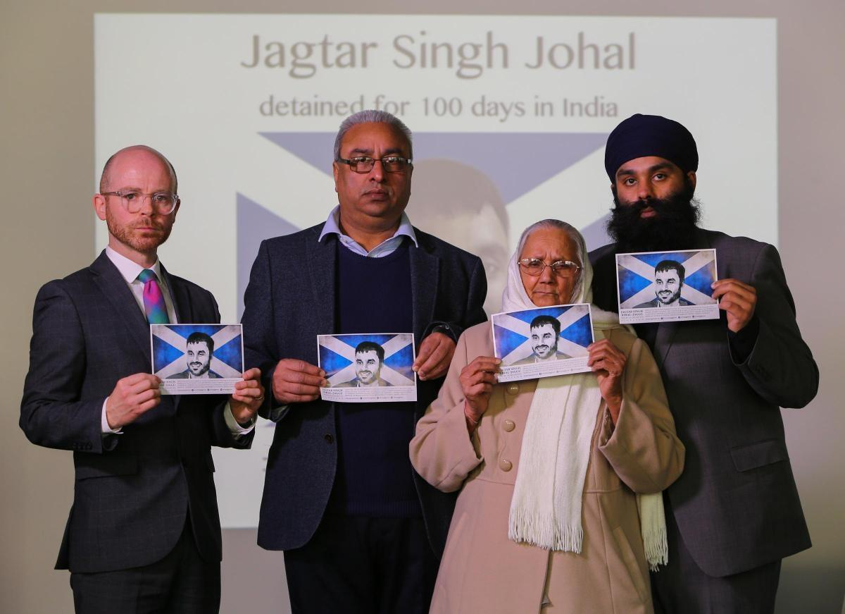Martin Docherty-Hughes MP alongside family of Jagtar Singh Johal