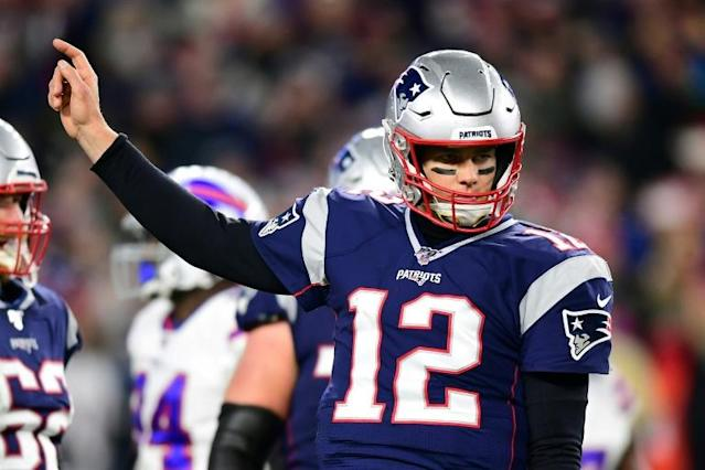 New England quarterback Tom Brady threw for 271 yards and a touchdown to spark the Patriots over Buffalo 24-17 in an NFL game (AFP Photo/Billie Weiss)