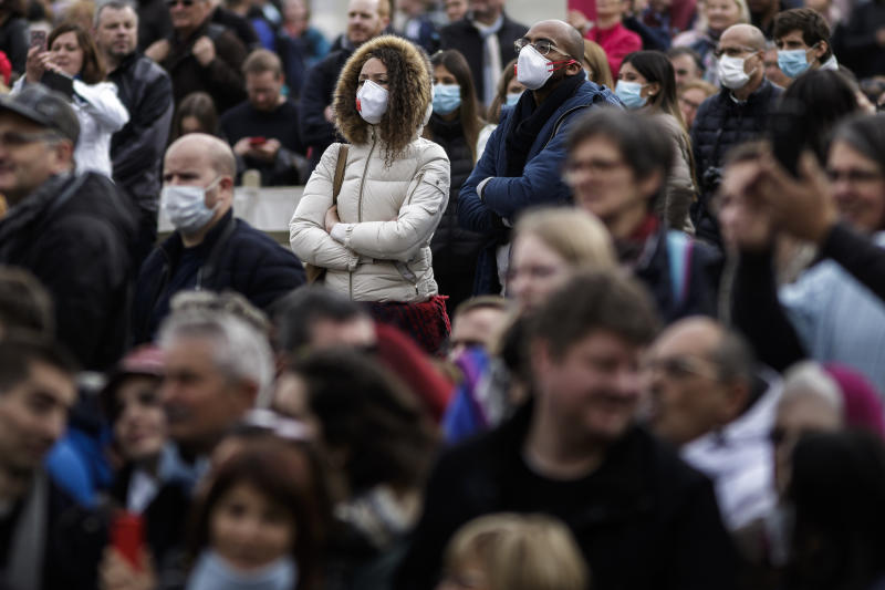 VATICAN CITY, VATICAN - 2020/02/26: People wear face masks as a precaution to the outbreak of Coronavirus in Italy, during the weekly General Audience at St. Peter's Square. The General Audience is held every Wednesday, in Saint Peter's Square, which can accommodate around 80,000 people. (Photo by Giuseppe Ciccia/SOPA Images/LightRocket via Getty Images)