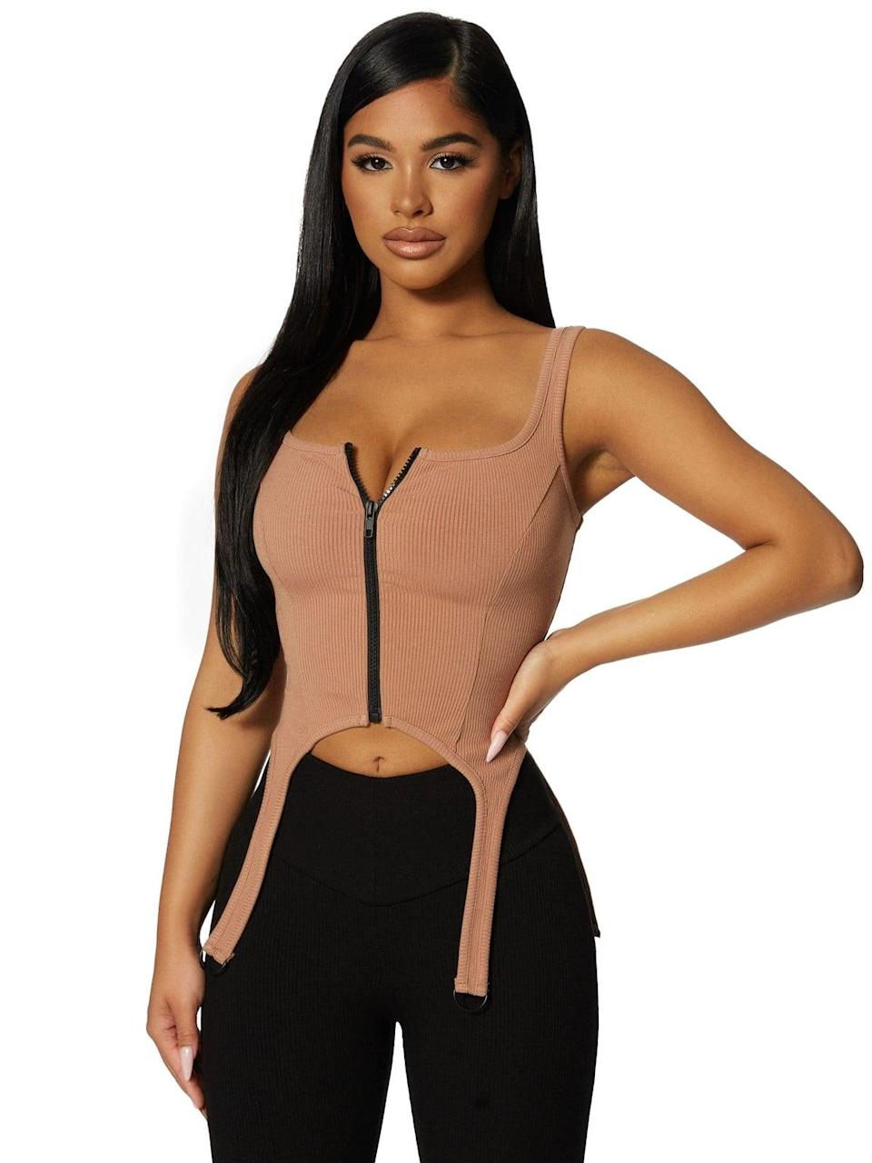 <p><span>Naked Wardrobe The Snatched &amp; Zipped Corset</span> ($62)</p>