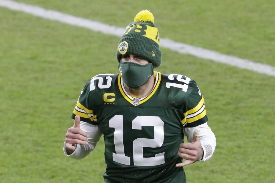 Green Bay Packers' Aaron Rodgers reacts as he runs off the field after an NFL football game against the Chicago Bears Sunday, Nov. 29, 2020, in Green Bay, Wis. The Packers won 41-25. (AP Photo/Mike Roemer)