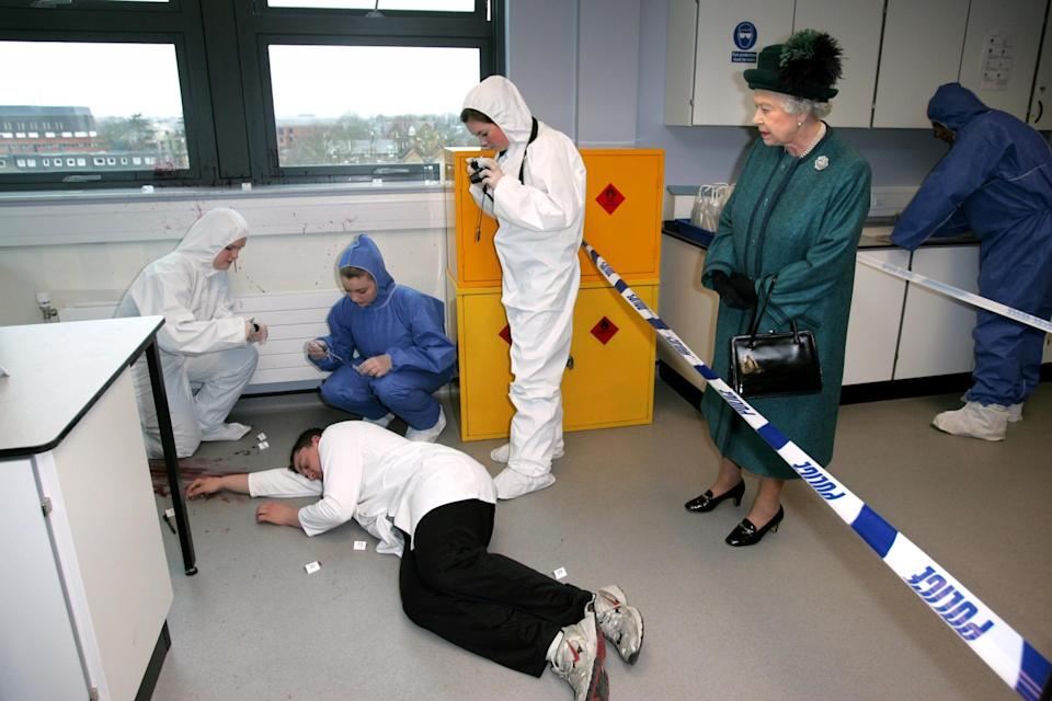 <p>Forensic science students demonstrate a simulated crime scene during a visit from The Queen. (PA) </p>