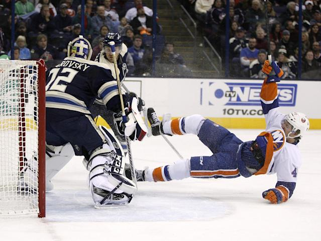 New York Islanders' Michael Grabner (40) falls after being pushed by Columbus' James Wisniewski (21) in front of goalie Sergei Bobrovsky (72), of Russia, during the first period of an NHL hockey game Saturday, Nov. 9, 2013, in Columbus, Ohio. (AP Photo/Mike Munden)