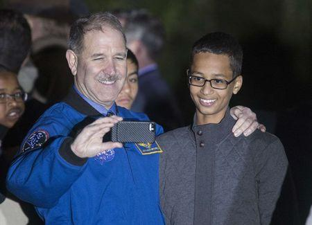 Grunsfeld, Associate Administrator for Science Mission Directorate, posing with Mohamed during White House Astronomy Night in Washington