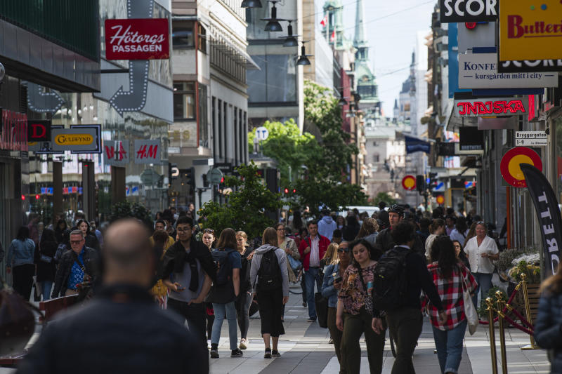 People walk in Drottninggatan during rush hour in Stockholm on May 29, 2020, amid the coronavirus COVID-19 pandemic. - Sweden's two biggest opposition parties called Friday for an independent commission to be appointed within weeks to probe the country's response to the new coronavirus. (Photo by Jonathan NACKSTRAND / AFP) (Photo by JONATHAN NACKSTRAND/AFP via Getty Images)