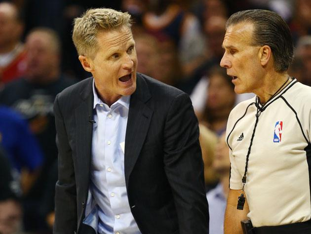 Steve Kerr asks a ref about his favorite cassette tapes. (AP)