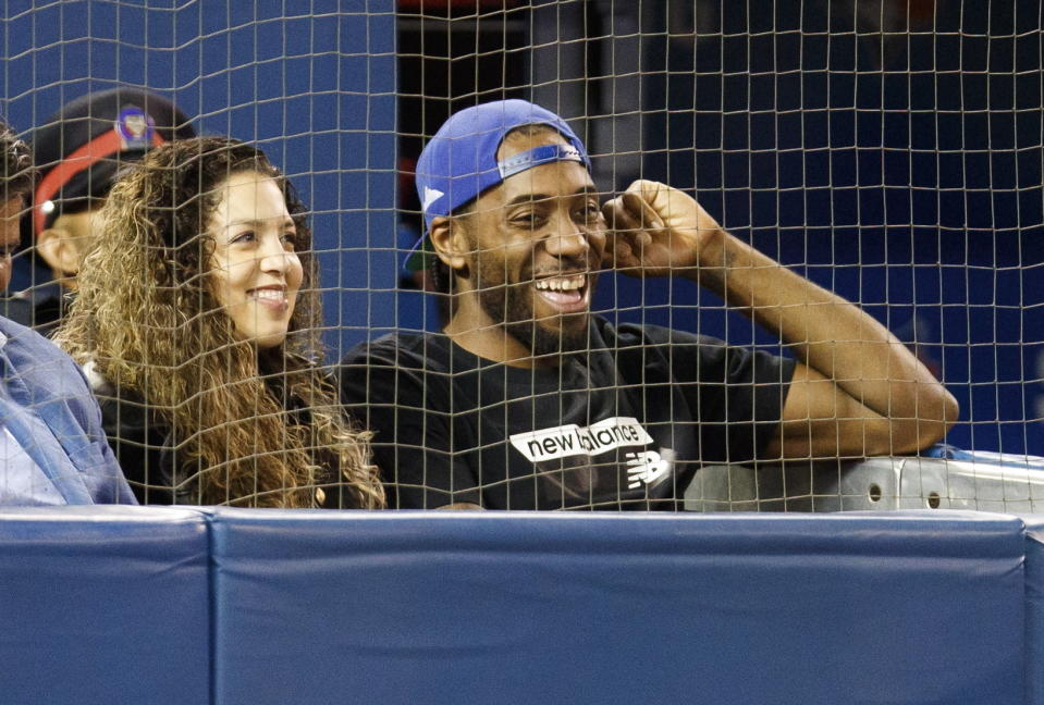 Kawhi Leonard and his girlfriend, Kishele Shipley, watch the Toronto Blue Jays play the Los Angeles Angels during a baseball game Thursday, June 20, 2019, in Toronto. (Mark Blinch/The Canadian Press via AP)