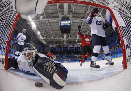 Ice Hockey – Pyeongchang 2018 Winter Olympics – Women Preliminary Round Match - U.S. v Canada - Kwandong Hockey Centre, Gangneung, South Korea – February 15, 2018 - Canada's Meghan Agosta scores against goalkeeper Madeline Rooney of the U.S. REUTERS/Grigory Dukor  TPX IMAGES OF THE DAY