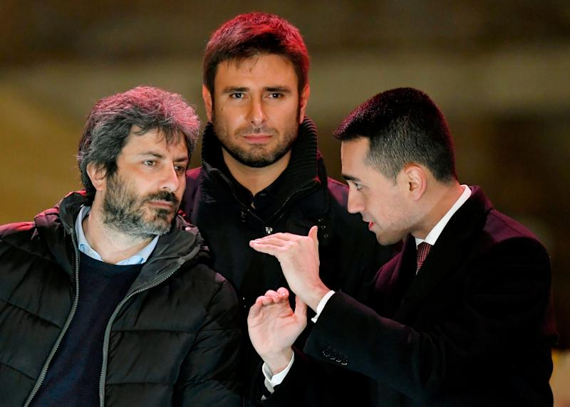 Italy's populist Five Star Movement (M5S) party leader Luigi Di Maio (R) and M5S members Roberto Fico (L) and Alessandro Di Battista after the last election campaign meeting in Piazza del Popolo in Rome on March 2, 2018. Italy's anti-establishment Five Star Movement broke with tradition on March 1, 2018, by announcing its list of ministerial candidates, almost all of them political newcomers, before March 4 general election. / AFP PHOTO / Andreas SOLARO (Photo credit should read ANDREAS SOLARO/AFP via Getty Images) (Photo: ANDREAS SOLARO via Getty Images)