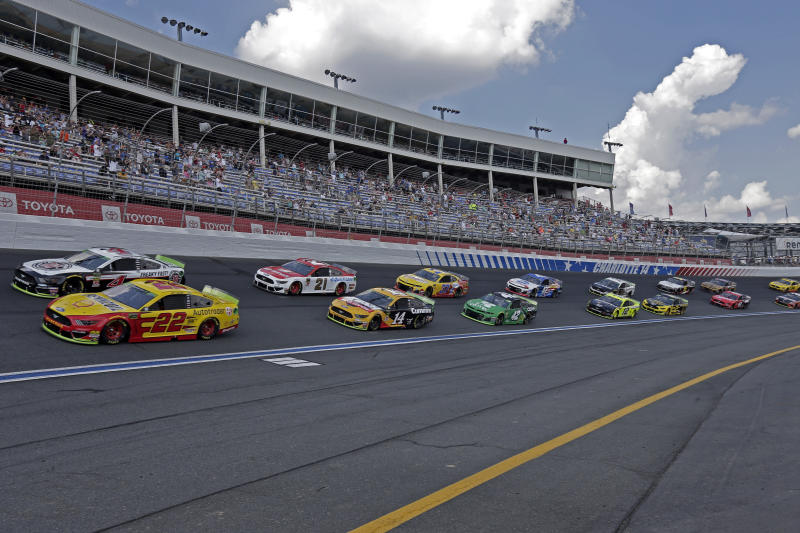 FILE - In this Sept. 29, 2019, file photo cars drive through Turn 4 to start the NASCAR Cup Series auto race at Charlotte Motor Speedway in Concord, N.C. General Motors is planning to open a new technical center for performance and auto racing near the Charlotte Motor Speedway. The center will focus on transferring auto racing knowledge into engineering for vehicles that are sold to the public. (AP Photo/Gerry Broome, File)