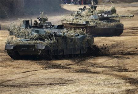 Japanese Ground Self-Defense Force (JGSDF) Type 10 armoured tanks take part in an annual new year military exercise with the JGSDF 1st Airborne Brigade at Narashino exercise field in Funabashi, east of Tokyo January 12, 2014. REUTERS/Issei Kato