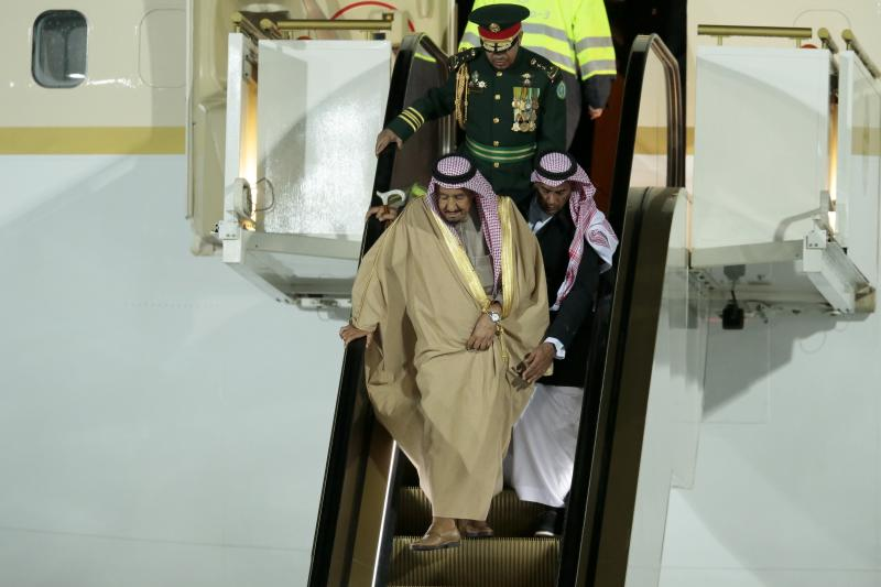 Making his own way down: Saudi King Salman was forced to walk down the steps of his gold escalator (AP Photo/Ivan Sekretarev)
