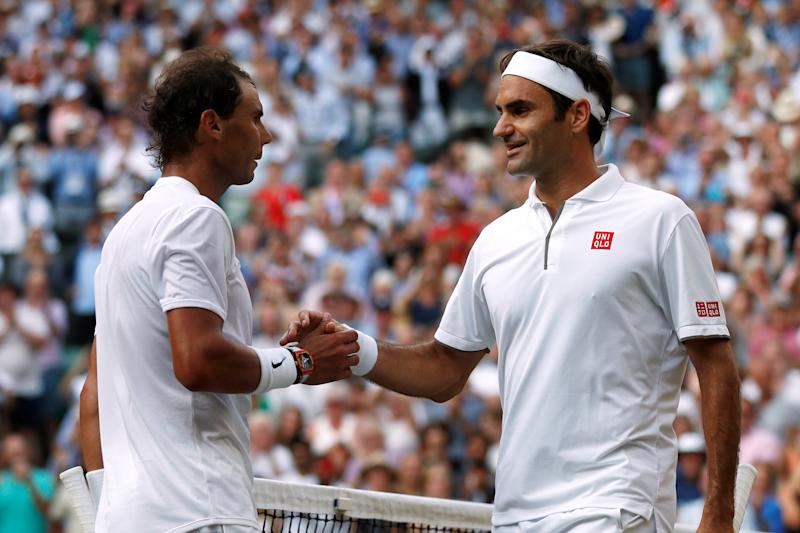 Tennis - Wimbledon - All England Lawn Tennis and Croquet Club, London, Britain - July 12, 2019 Switzerland's Roger Federer with Spain's Rafael Nadal after winning their semi-final match Adrian Dennis/Pool via REUTERS
