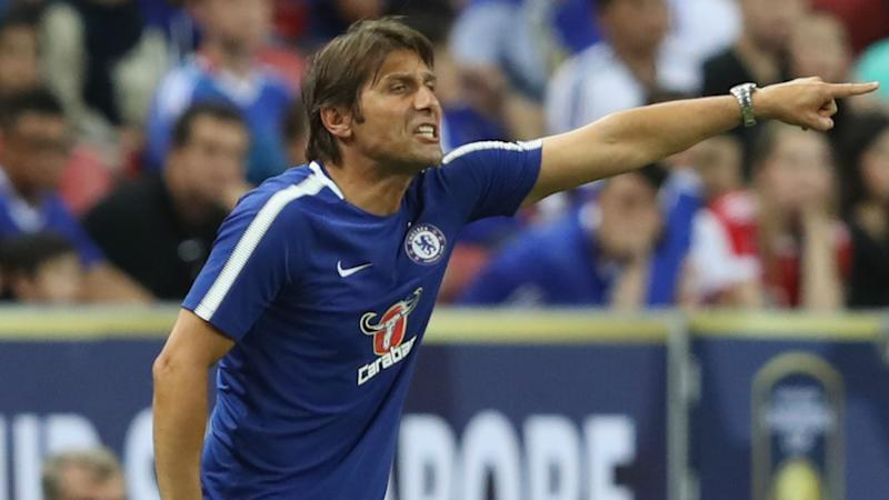 Conte fires back at Wenger, says