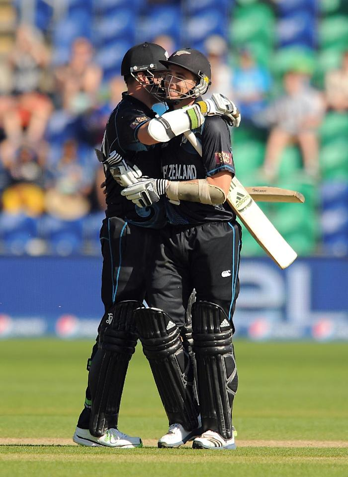 New Zealand's Mitchell McClenaghan (left) and team mate Tim Southee congratulate each other after they win the ICC Champions Trophy match at the SWALEC Stadium, Cardiff.