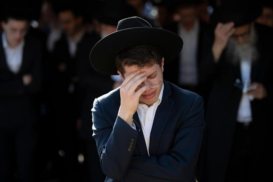 <p>A mourner at a funeral ceremony for the victims</p> (AP)