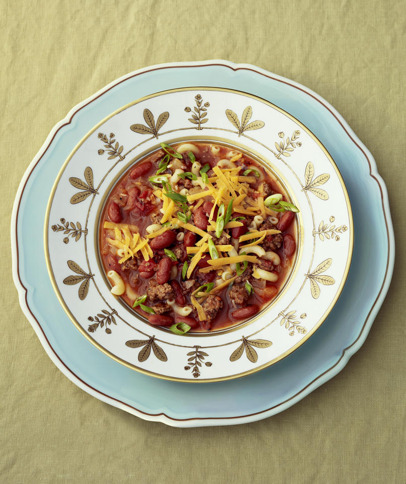 """<p>Just as Cincinnati chili is served over spaghetti, this chili mac is made better with elbow noodles. The veggies, meat, and broth simmer together in one pot, making the entire process (including clean-up!) a breeze.Garnish each bowl with shredded sharp cheddar and sliced scallions, then serve alongside a slab of warm corn bread.<br /> <br /> <a rel=""""nofollow"""" href=""""http://www.realsimple.com/food-recipes/browse-all-recipes/classic-american-chili-mac-elbows"""">Get the recipe</a>.</p>"""