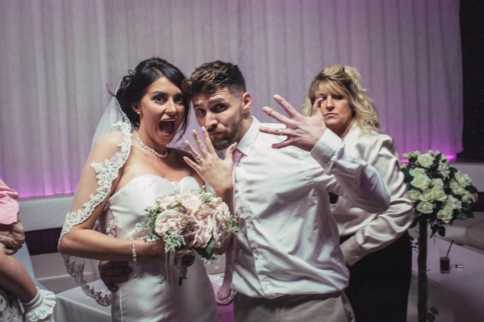 The happy couple show off their wedding rings (SWNS)