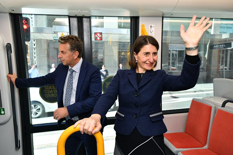 Pictured is NSW Premier Gladys Berejiklian and NSW Minister for Transport Andrew Constance onboard a trial tram in Sydney