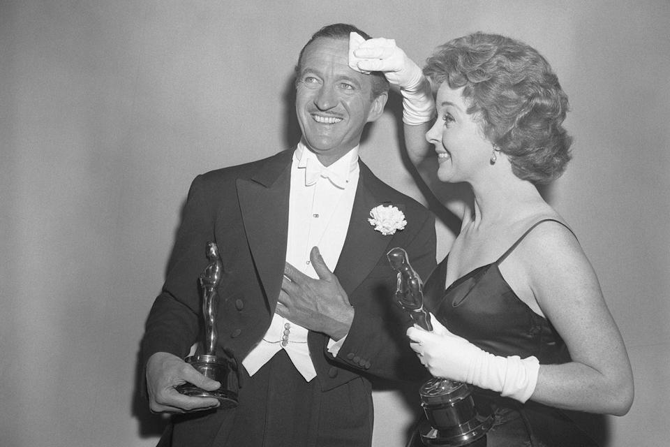 "<p> Susan Hayward wiped the sweat off David Niven's brow as they posed for photos after winning the Best Actor and Actress Oscars. She won for <em><a href=""https://www.amazon.com/dp/B000RLDJXW?ref=sr_1_1_acs_kn_imdb_pa_dp&qid=1547578261&sr=1-1-acs&autoplay=0&tag=syn-yahoo-20&ascsubtag=%5Bartid%7C10055.g.5132%5Bsrc%7Cyahoo-us"" rel=""nofollow noopener"" target=""_blank"" data-ylk=""slk:I Want to Live"" class=""link rapid-noclick-resp"">I Want to Live</a></em> and he won for <em><a href=""https://www.amazon.com/dp/B001NVEFDS?ref=sr_1_1_acs_kn_imdb_pa_dp&qid=1547578278&sr=1-1-acs&autoplay=0&tag=syn-yahoo-20&ascsubtag=%5Bartid%7C10055.g.5132%5Bsrc%7Cyahoo-us"" rel=""nofollow noopener"" target=""_blank"" data-ylk=""slk:Separate Tables"" class=""link rapid-noclick-resp"">Separate Tables</a></em>. Meanwhile, that year, host Jerry Lewis scrambled to fill the time when the final award was given out 20 minutes before the show was scheduled to end.</p>"