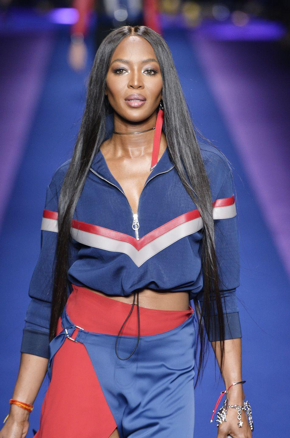"<p>The iconic supermodel was only 15 when she was spotted by Pennington Models scout Beth Boldt.</p><p>""A woman came up to me and asked if I'd ever thought of modelling. It was Beth Boldt, head of the Synchro agency. My immediate reaction was surprise and excitement,"" Campbell told <em><a href=""https://www.theguardian.com/fashion/2016/mar/19/naomi-campbell-modelling-bob-marley-putin-autobiography-extract"" rel=""nofollow noopener"" target=""_blank"" data-ylk=""slk:The Guardian."" class=""link rapid-noclick-resp"">The Guardian.</a></em> ""My mum wanted me to stay on at school and finish my exams. But I wanted things my way, so a few weeks later I went to see Beth on my own. On my first visit, she parted my hair in the middle, did my makeup and took me up on the roof in my school uniform to take a few black-and-white pictures. Eventually, Mum decided I could model, so long as it didn't interfere with my school work or exams."" </p><p>In January 1990, Campbell was declared ""the reigning megamodel of them all"" by <em><a href=""https://people.com/archive/a-night-with-the-cover-girls-vol-33-no-23/"" rel=""nofollow noopener"" target=""_blank"" data-ylk=""slk:Interview"" class=""link rapid-noclick-resp"">Interview</a></em>. Most famously, she was also part of The Big Five supermodels of the '90s—going on to become a runway icon and the face of endless major fashion campaigns.<br></p>"