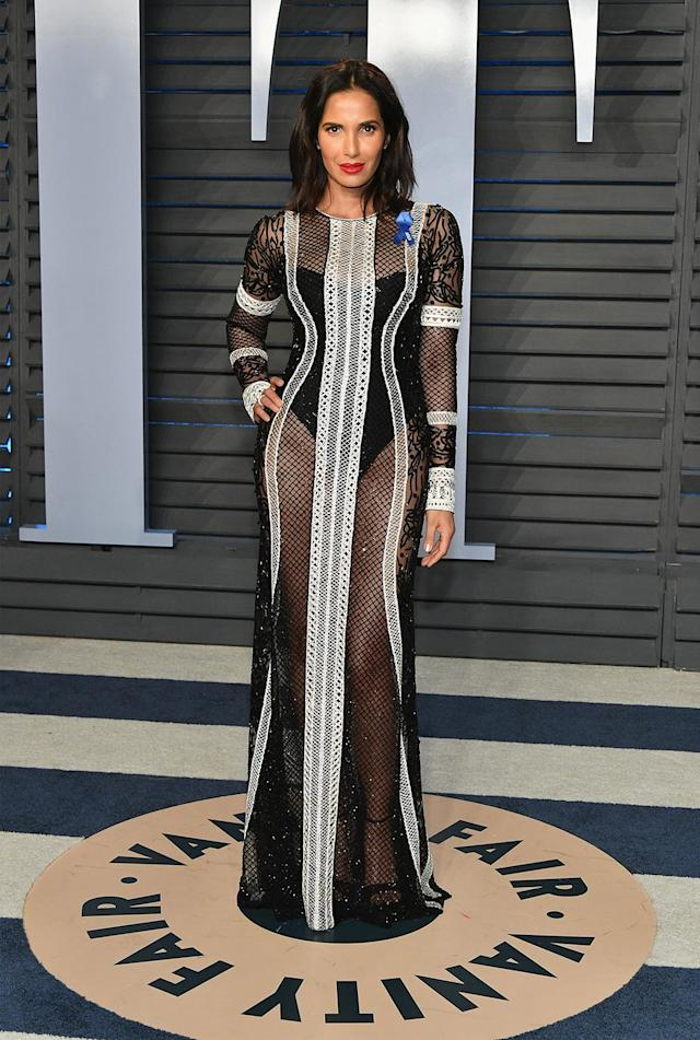 <p>The <em>Top Chef</em> host's slinky, sheer gown turned heads on the <em>Vanity Fair</em> red carpet. (Photo: Dia Dipasupil/Getty Images) </p>