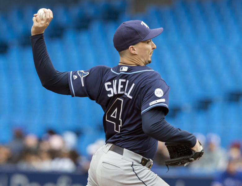 Tampa Bay Rays starting pitcher Blake Snell throws against the Toronto Blue Jays during the first inning of a baseball game in Toronto, Sunday, Sept. 29, 2019. (Fred Thornhill/The Canadian Press via AP)
