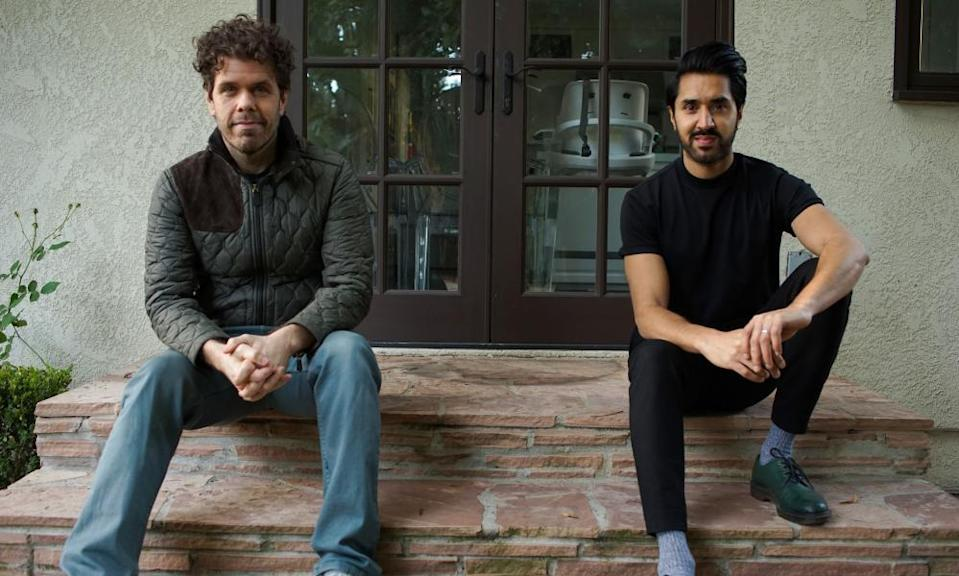 Celebrity blogger Perez Hilton, left, at his LA home with Mobeen Azhar.