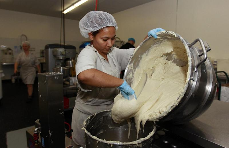 "In this Thursday, July 14, 2012 photo, Bertha Domimguez prepares gluten-free dough at Pure Knead bakery sandwich bread in Decatur, Ga. Scientists suggest that there may be more celiac disease today because people eat more processed wheat products than in decades past, which use types of wheat that have a higher gluten content. Or it could be due to changes made to wheat, said the Mayo Clinic's Dr. Joseph Murray. In the 1950s, scientists began cross-breeding wheat to make hardier, shorter and better-growing plants. It was the basis of a so-called ""Green Revolution"" that boosted wheat harvests worldwide. (AP Photo/John Bazemore)"