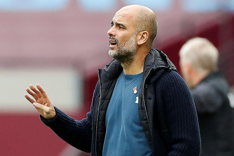 Long way to go: Manchester City manager Pep Guardiola played down the importance of Sunday's clash with Liverpool