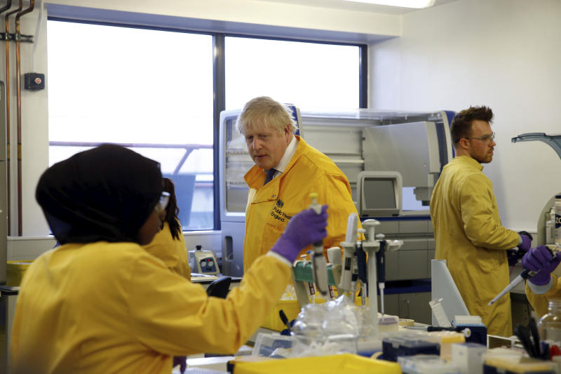 Britain's Prime Minister Boris Johnson visits a laboratory  at the Public Health England National Infection Service, after more than 10 new coronavirus patients were identified in England, in Colindale, north London, Sunday, March 1, 2020. (Henry Nicholls/Pool Photo via AP)