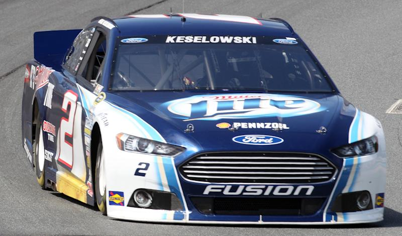 Brad Keselowski rounds Turn 2 during practice for Sunday's NASCAR Sprint Cup auto race at New Hampshire Motor Speedway, Friday, July 12, 2013, in Loudon, N.H. Keselowski went on to win the pole position during qualifying for Sunday's race. (AP Photo/Jim Cole)