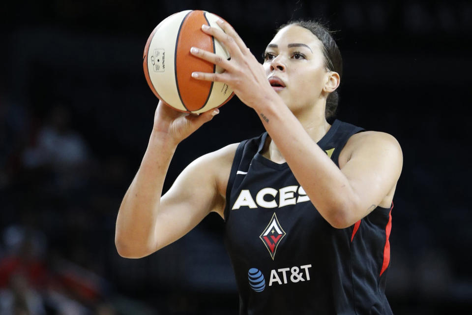 FILE - In this Sept. 24, 2019, file photo, Las Vegas Aces' Liz Cambage (8) shoots against the Washington Mystics during the first half of Game 4 of a WNBA playoff basketball series in Las Vegas. Cambage will miss the upcoming WNBA season after she was medically excused. By being granted the medical excuse, Cambage will be paid her full salary for the season by the Aces. (AP Photo/John Locher, File)