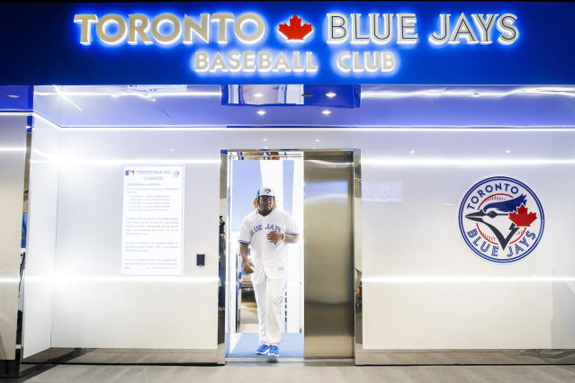 Toronto Blue Jays rookie Vladimir Guerrero Jr. walks out of the clubhouse to speak at a news conference before his major league debut against the Oakland Athletics in a baseball game Toronto, Friday April 26, 2019. (Mark Blinch/The Canadian Press via AP)