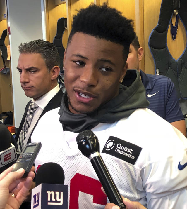 New York Giants NFL football running back Saquon Barkley speaks to reporters in East Rutherford, N.J., Tuersday, Oct. 9, 2018. (AP Photo/Tom Canavan)