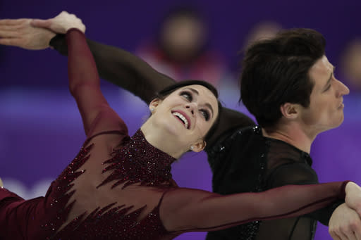 FILE - In this Feb. 20, 2018 file photo, Tessa Virtue and Scott Moir of Canada perform during the ice dance, free dance figure skating final in the Gangneung Ice Arena at the 2018 Winter Olympics in Gangneung, South Korea. Canada won the most medals in figure skating with four at the 2018 Winter Games. They did it with a veteran team led by Virtue and Moir, whose two golds gave them a record five Olympic medals. However, with the pair headed for retirement for the second time, Canada will need to find a new wave of skaters to keep them on top as they look ahead to the 2022 Games. (AP Photo/Julie Jacobson, File)