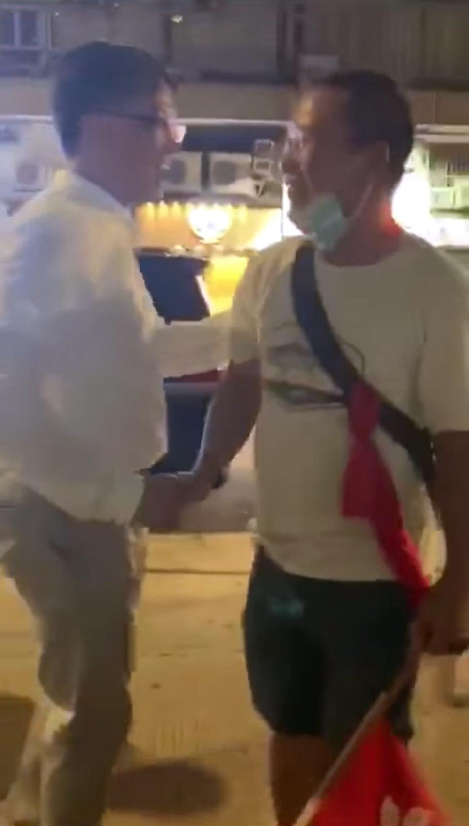 Junius Ho (left) shakes hands with a man in a white T-shirt in Yuen Long. Photo: Facebook
