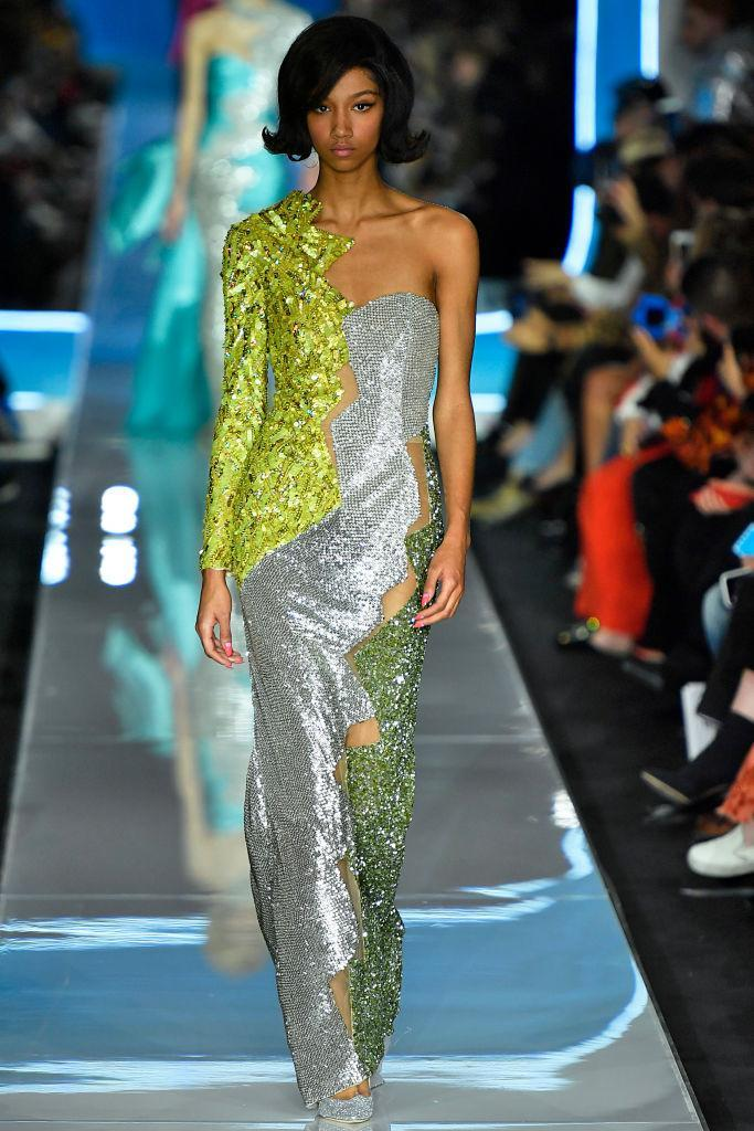 <p>A green-and-silver sequined dress at the Moschino FW18 show. (Photo: Getty) </p>