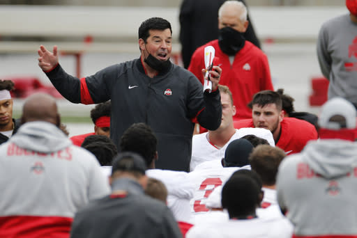 FILE - In this Saturday, Oct. 3, 2020, file photo, Ohio State head coach Ryan Day talks to his team during their NCAA college football practice, in Columbus, Ohio. As Alabama, Ohio State, Clemson, Oregon, Notre Dame, Oklahoma and Florida prepared to play for conference championships, they signed top-10 recruiting classes for 2021 they hope to fuel their next title contenders..(AP Photo/Jay LaPrete, File)