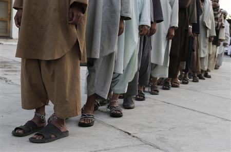 Prisoners who escaped from Kandahar's Sarposa jail on Monday are presented to the media after they were recaptured, in Kandahar
